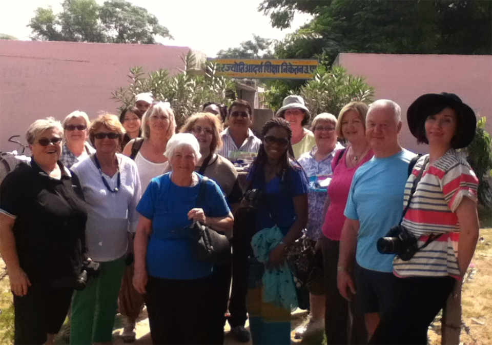 Satendra and his most recent group of happy travelers from 'On The Go' at the village primary school in Abhaneri, Rajasthan.